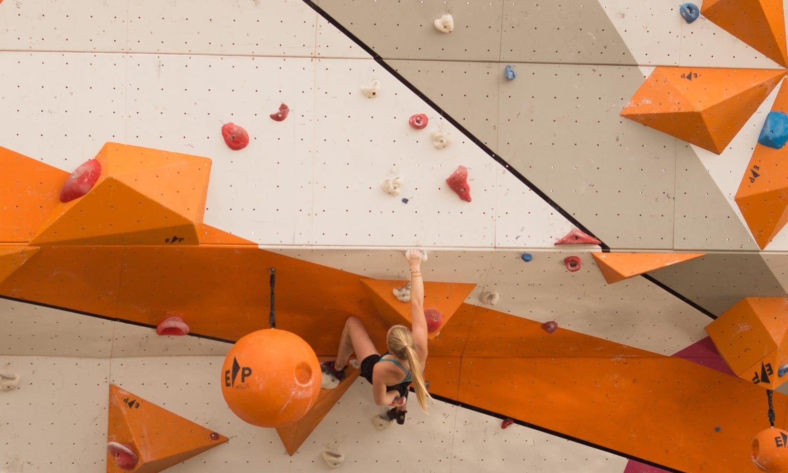 women-climbing-wall